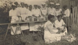 African American women shucking corn and making preserves in Conecuh County, Alabama.