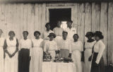 African American women standing around a table of baked goods in Madison County, Alabama.