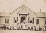 Students and faculty in front of the public school in Wilmer, Alabama.