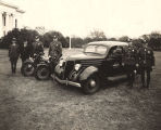 Five officers of the Alabama Highway Patrol with motorcycles and a patrol car on the lawn of the...