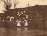 Young women on the bank of a spring near Montevallo, Alabama.