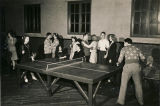 Teenagers playing table tennis at a youth club in Alabama.