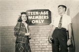 Teenagers entering a youth club in Alabama.