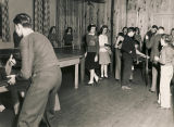 Teenagers playing table tennis and billiards at a youth club in Alabama.