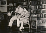 Serviceman and young woman in the reading room at the USO club in Talladega, Alabama.