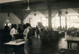 Servicemen playing cards and games in the recreation room at the African American USO club in...