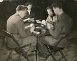 Servicemen and young women playing cards at the Army Y.M.C.A. in Anniston, Alabama.