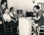 """Miss Evah Miller, assistant director of USO Unit (YWCA) goes over plans for Physical Fitness..."