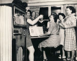 """The USO (YWCA) Unit in Mobile is a popular place for soldiers' wives and defense industry..."