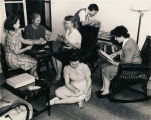USO - (YWCA) club rooms are a popular drop-in for defense industry working girls and soldiers'...