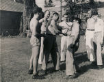 Private Capucci disarming Private Louis Pappiano during a jujitsu class at the USO club in Mobile,...