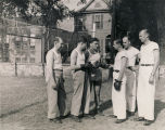 Jay Archer, assistant director of the USO club in Mobile, Alabama, teaching a boxing class to...