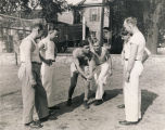Jay Archer, assistant director of the USO club in Mobile, Alabama, teaching a wresting class to...