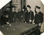 Members of the Coast Guard playing billiards at the USO club in Mobile, Alabama.
