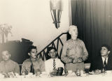 Officer addressing men during a communion supper at the USO in Mobile, Alabama.