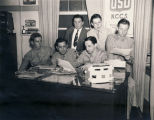 Servicemen working on the club newspaper in the director's office at the USO club in Mobile,...
