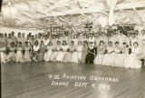 Servicemen and young woman at a dance sponsored by the 4th Aviation Squadron, held at the African...