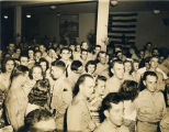 Servicemen and young women at a formal dance at the USO Soldiers Center in Montgomery, Alabama.