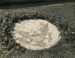 Garden decoration in the shape of the United States seal at the German POW camp in Aliceville,...