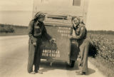 Two women behind a Red Cross Clubmobile on a road in western Europe.
