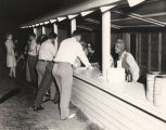 Men and women getting refreshments from an outdoor canteen in Montgomery, Alabama.