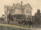 Mrs. Kate V. Hardeman with her husband in a victoria in front of their house in Birmingham,...
