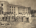 Crew standing in front of the newly completed building for the State Highway Department in...