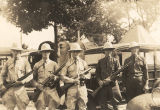 Five MPs of the New York National Guard holding guns at Camp Smith.
