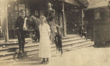 Alice Cox, E. G. Smitherman, and others in front of Cox store, probably in Randolph, Alabama.