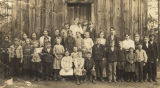 Students standing in front of a one-room schoolhouse in Randolph, Alabama.