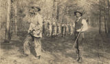 French Duke and E. G. Smitherman displaying the rabbits they have killed while hunting.