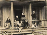 Family on the porch of a house in Sand Mountain, a community in Bibb County, Alabama.