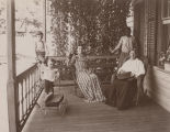 Women and children on a porch in Mobile County, Alabama.