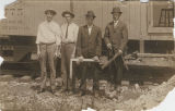 William Grant Crosswhite and three other men, all employees of the Alabama Great Southern Railroad.