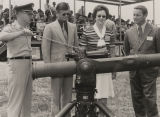 """Mrs. Agnes Baggett examining military hardware with the President Pro Tempore of the Alabama..."