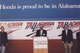 Honda executive addressing a crowd at the Talladega Superspeedway.