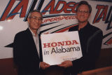 "Governor Don Siegelman and a Honda executive holding a sign that says ""Honda in Alabama."""