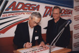 "Honda executive autographing a sign that says ""Honda in Alabama."""