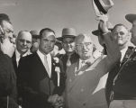 Governor John Patterson shaking hands with Harry S. Truman during the former president's visit to...