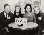 Governor John Patterson, Lady Bird Johnson, and two unidentified young women seated at a table,...