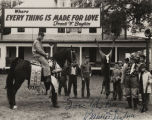 Governor John Patterson sitting on a horse in front of Congressman Frank W. Boykin's hunting lodge...