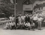"John Patterson with a group of men in front of a store called ""Collards 'n Everything."""