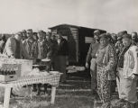 John Patterson and other men gathered for a meal during a hunting trip.