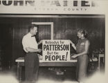 Man and woman in Etowah County holding up a John Patterson sign during the 1958 gubernatorial...