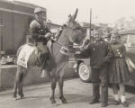 Jimmy, Richard, and Linda Thrasher with a donkey, campaigning for John Patterson during the 1958...