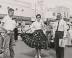 "Woman wearing a ""Vote for Patterson"" skirt during the 1958 gubernatorial campaign."