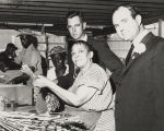 Governor John Patterson with employees packaging sea oats at a plant in Alabama.