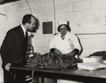 Governor John Patterson with an employee packaging hickory smoked sausages at the Conecuh Quick...