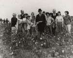 Governor John Patterson standing in a cotton field with a group of children and several adults.