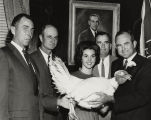 Bill Bates (far left) presenting a turkey to Governor John Patterson.